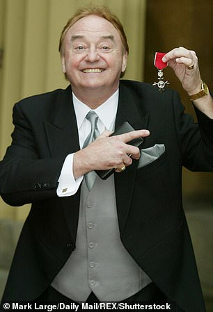 An honour: Gerry received an MBE for Services to Liverpudlian charities at Buckingham Palace in 2003